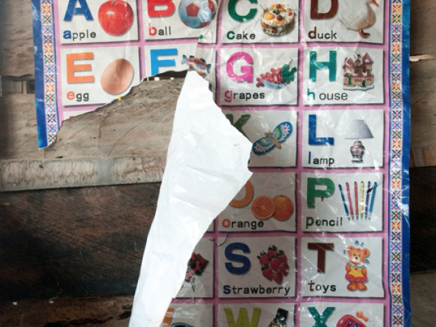 A torn alphabet poster hangs in the nursery of Desmercy School, where the students come from relatively low-income families. Though the school has benefited thanks to microfinance loans from Opportunity International, parents such as Richard Dedzoe, a mason, and Florence Oppong, a trader in foodstuffs, hope Opportunity International will further assist the school in improving its  computer training and plumbing.