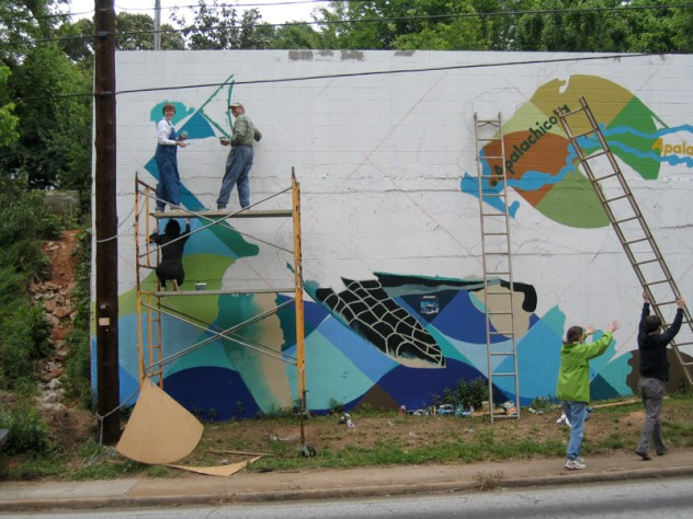 Community volunteers painting <i>Native Waters</i> in Atlanta, Georgia.