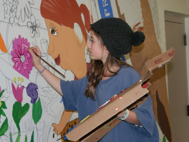 Student working on <i>Lawrence School Garden Mural</i>