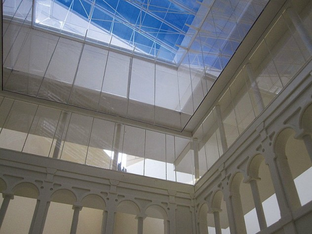 A rendering of the new building shows how the courtyard opens up to the glass lantern high above.