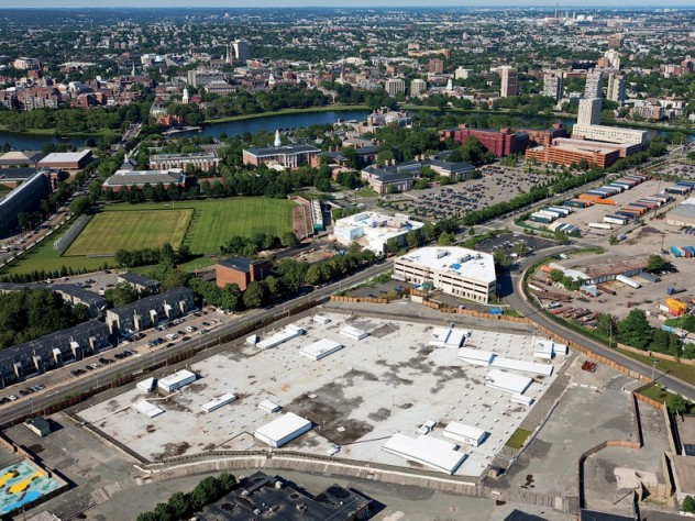 "From a vantage point south of Western Avenue in Allston, looking northeast toward Harvard Square, the unfinished science complex dominates the foreground. Beyond it lie athletic fields that may yield to expansion by the School of Public Health, the Graduate School of Education, or other academic enterprises. A business ""enterprise research campus"" is envisioned south of Western Avenue, across from the high-rise graduate-student housing at One Western Avenue."