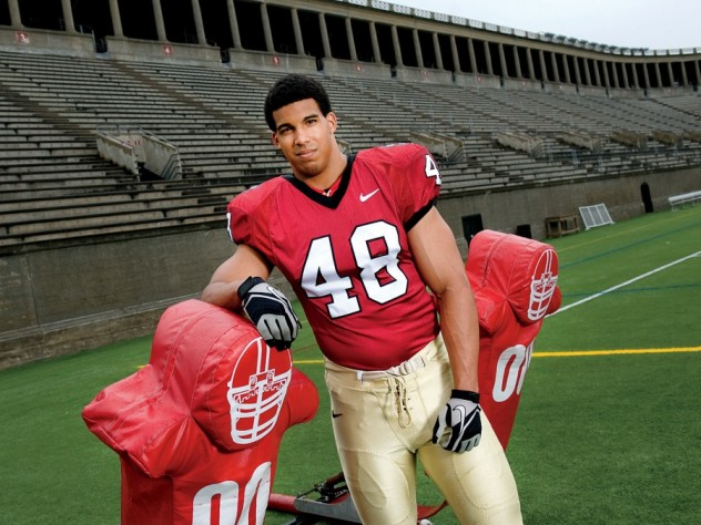 Defensive tackle Josue Ortiz with a blocking sled at Harvard Stadium