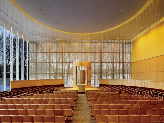 The interior of Temple Beth Elohim in Wellesley, Massachusetts, looking onto a wooded landscape