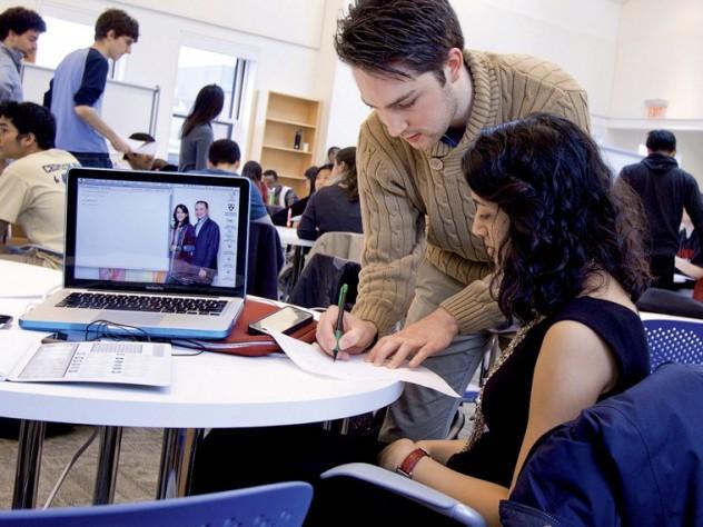 Course assistant Ben Adlam works with Raina Gandhi