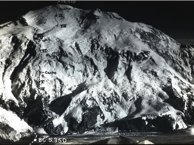 Aerial photographs taken by cartographer Bradford Washburn '33 showed a shallow ridge that snaked vertically up the face of the Wickersham Wall. Marked on the photograph is the route taken by the Harvard team and the location of their camps.