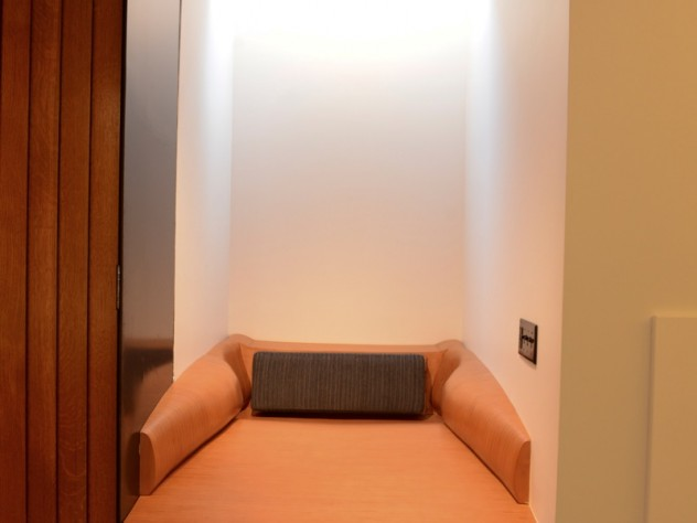 Small alcoves on the basement level boast skylights and comfortable cushions for studying and resting.
