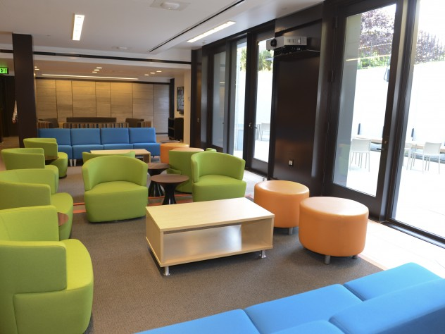Colorful furniture in the basement-level common room next to the terrace. A student committee was consulted on furniture choices.