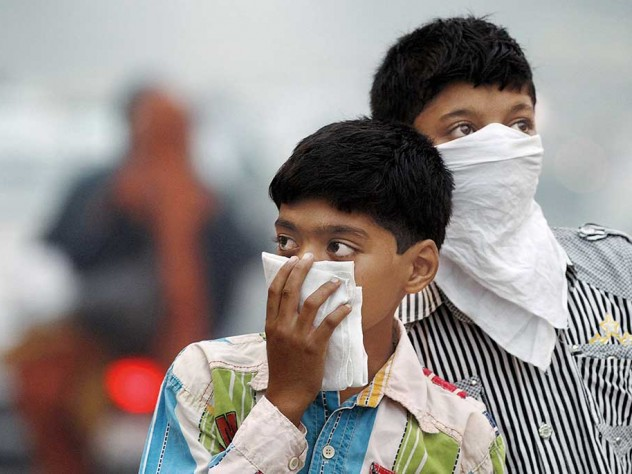 Children protecting themselves from smog and pollution, New Delhi, 2012