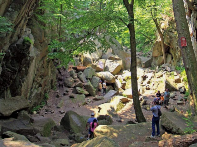 Hikers stand in Purgatory Chasm, near Worcester, Massachusetts