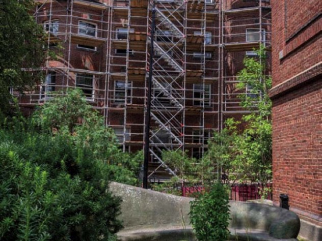 Photograph showing scaffolding for renovation of Harvard's Adams House undergraduate residence