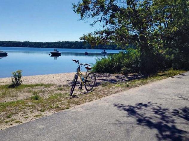 Bike trail scene of Classic Cape Cod sand, water, and sky