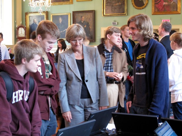 President Faust looks on as freshmen sign up for TurboVote.