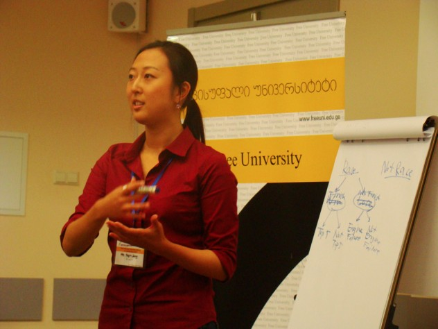 Instructor Sujin Jang leads a case study discussion at ISS 2012.