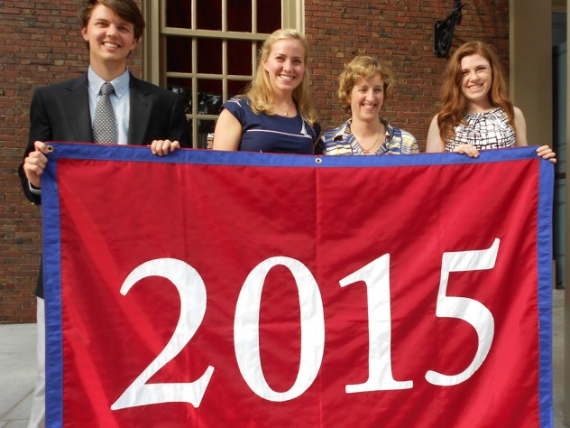 Holding their blue-trimmed class banner, sophomore class Undergraduate Council representatives Chris Smiles (at left) and Ryley Reynolds flank Catherine Katz '13 and associate dean of Harvard College Joan Rouse. Katz first proposed a sophomore class event to administrators. Smiles and Reynolds are also members of the Harvard Alumni Association's Building Community Committee.
