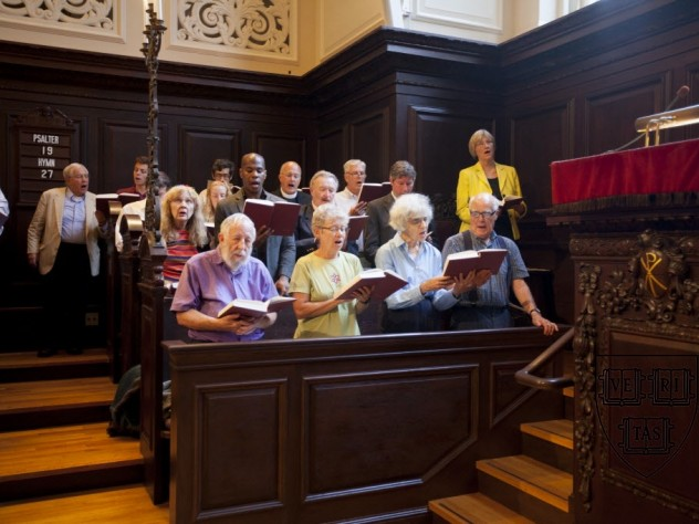 President Faust (standing at upper right, during the singing of Hymn 27) spoke at the first Morning Prayers of the new academic year.