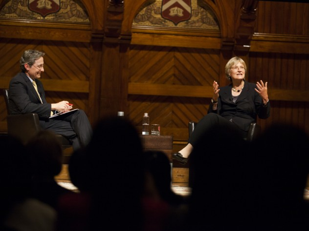 "Harvard Business School professor Herman ""Dutch"" Leonard relayed audience questions to President Faust following her address."
