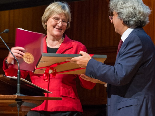 """GSD dean Mohsen Mostafavi awards President Drew Faust an honorary certificate naming her a """"grounded visionary"""" during Friday's opening event in Sanders Theatre."""