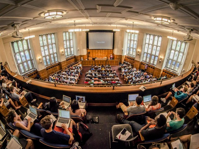 Photo of Yale students attending CS50 in the Yale Law School auditorium