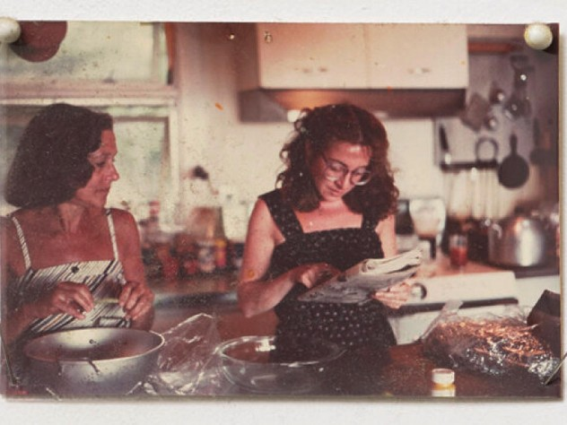 Undated snapshot of Marilyn Pappas and Jill Slosburg-Ackerman as younger women cooking together.