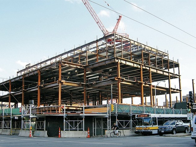 Structural steel is erected for the Law School's Wasserstein Hall, Caspersen Student Center, and clinical-wing project on Massachusetts Avenue at Everett Street.