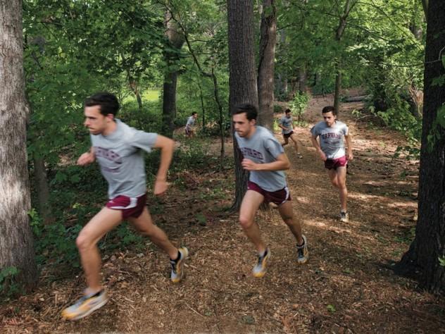 Cross-country captain Daniel Chenoweth  running hill repeats at Fresh Pond