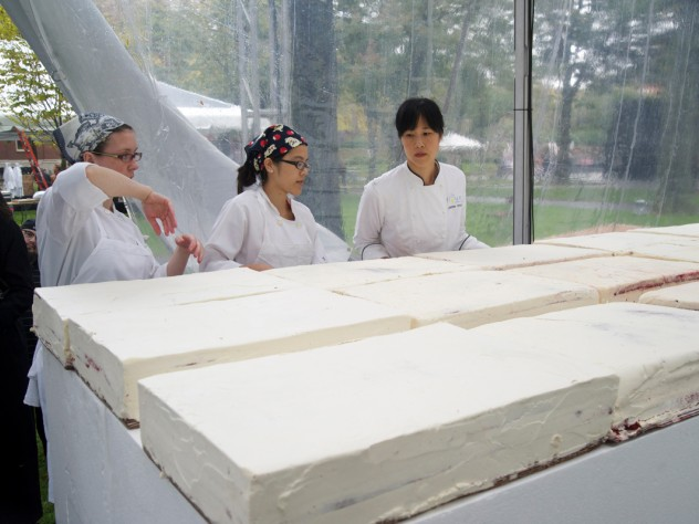 Chang and employees keep working to align the cakes precisely.