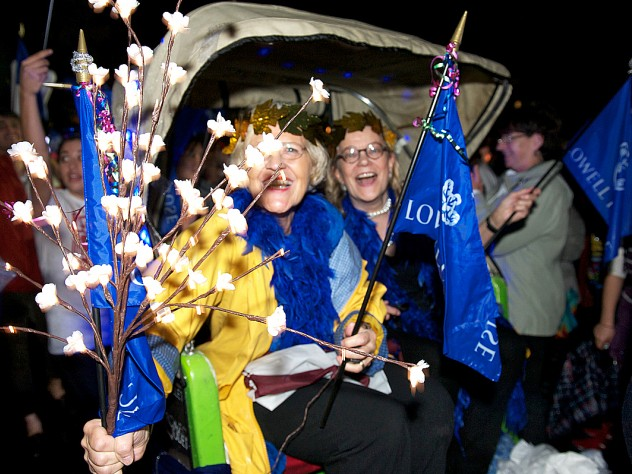 Lowell House co-masters Dorothy Austin and Diana Eck were carried by House residents in a rickshaw as part of the parade.