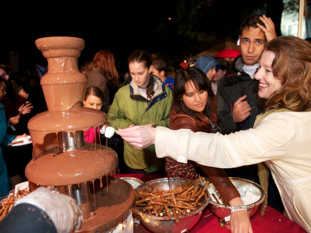 Party-goers enjoy one of two chocolate fountains. The food tents were popular as people crowded underneath to get out of the downpour.