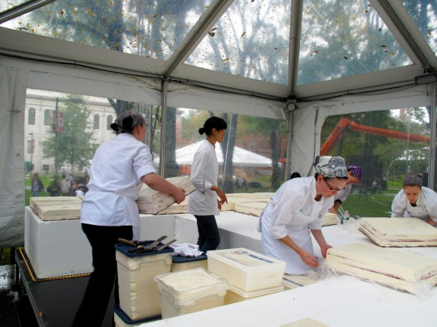 Employees unwrap and arrange the sheets as Flour owner Joanne Chang '91 looks on.