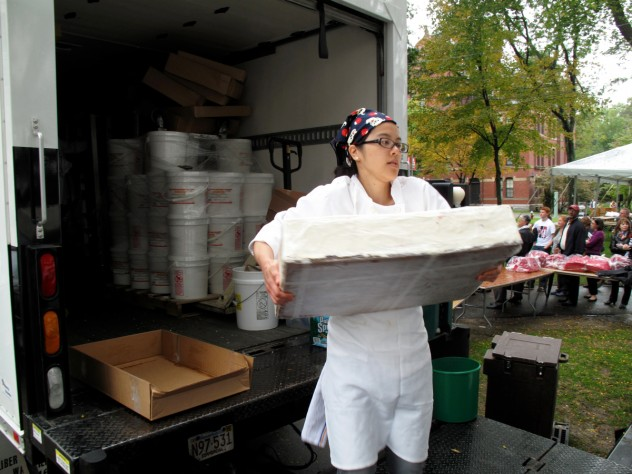 A Flour bakery employee unloads one of the layered sheet cakes.
