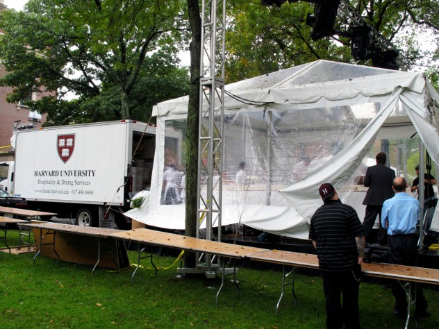 Workers assembled the cake under a tent to protect it from the rainy weather. A Harvard Dining Services truck brought over the individual sheet cakes, which form the 15-by-18-foot H-shaped cake. Sixty individual sheet cakes were baked, two per day, by Flour bakery and deep frozen at Harvard awaiting the day of the celebration.