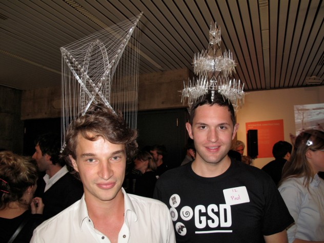 Two more Design School students show off their entries in the headdress competiton. The grand prize was an iPad 2.