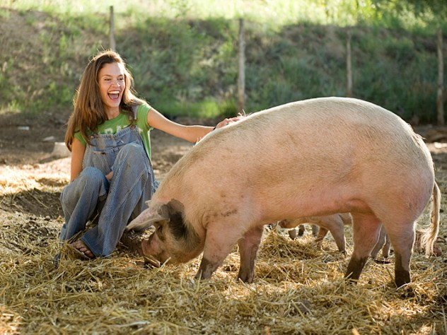 Wade with one of her composting pigs, which recycle all the restaurant's food waste