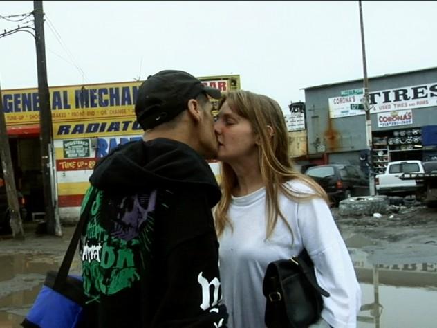 Sara and Luis share a kiss.