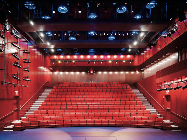 The intimate performance space, seen from the stage, is equipped with thoroughly modern theater technology.