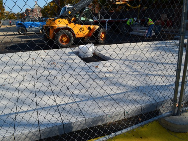 15. From the western edge of the plaza space, new surface pavers, finished with an aggregate of crushed, recycled porcelain, were being installed, with spaces for permanent seating to come during a later phase of the construction.