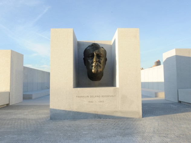 An enlarged version of the famous bronze bust of Roosevelt created by American sculptor Jo Davidson appears at the threshold of a square, white-granite, open-air plaza.
