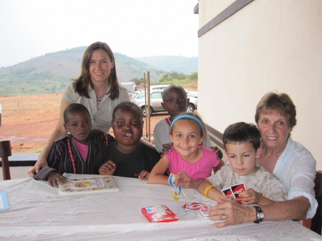 Betancourt with her children, Anna and Joey; her mother, Norma; and their friends Didier, Yvonne, and Pabelo at the Inshuti Mu Buzima/Partners In Health District Hospital in Rwanda