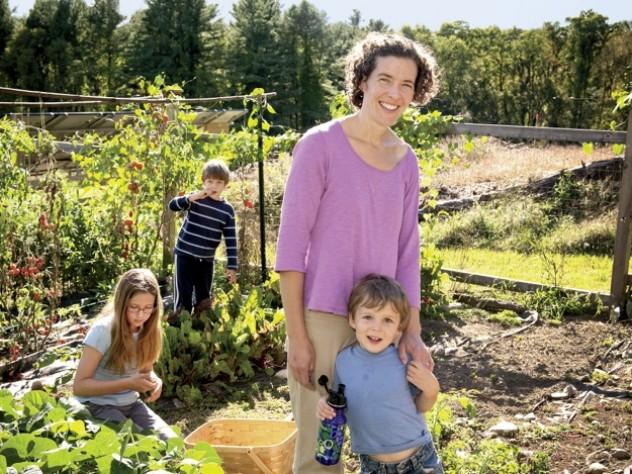 Zoe Resch with her children (clockwise from left) Prairie (9), Silas (7), and Calder (3) in their family vegetable garden in Vermont