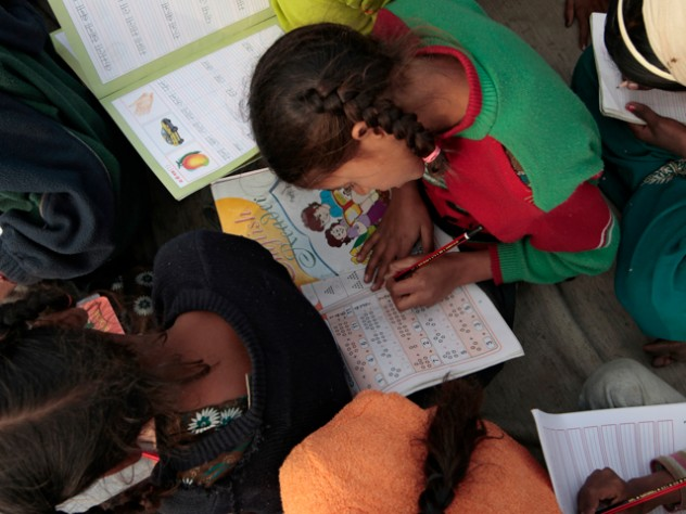 Even those who don't attend school can come to the center for basic literacy education.