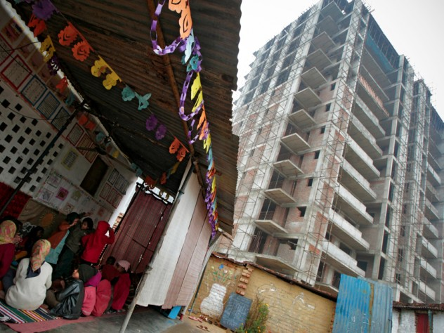 Under Indian law, construction sites with a certain number of female workers are supposed to operate a childcare center, but few do. The nongovernmental organization Mobile Crèches contracts with some construction companies to run such centers, like this one in Gurgaon.
