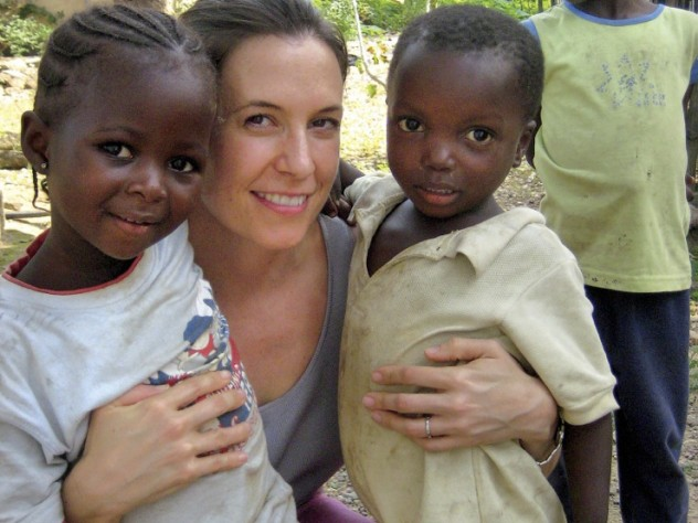 At left, Betancourt with young friends Binta and Christopher in Koidu Town, Kono District, Sierra Leone.