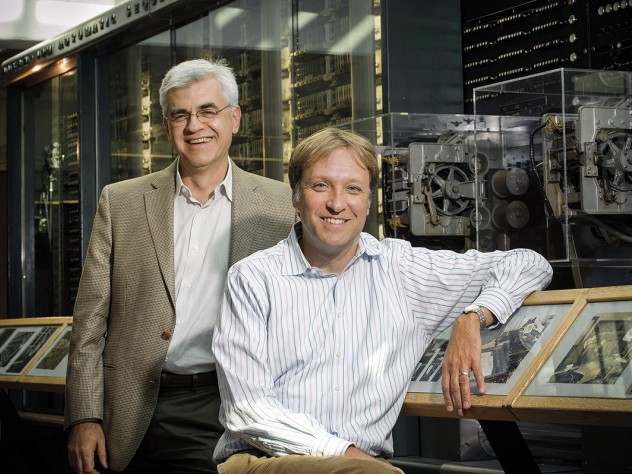 Efthimios Kaxiras (left) and Hanspeter Pfister in front of a portion of Howard Aiken's Mark I computing machine