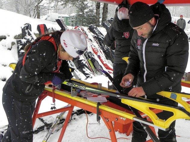 Harvard's Nordic ski team head coach Chris City tests waxes with racer Alena Tofte '13 before the Dartmouth Carnival in Craftsbury, Vermont, last winter.