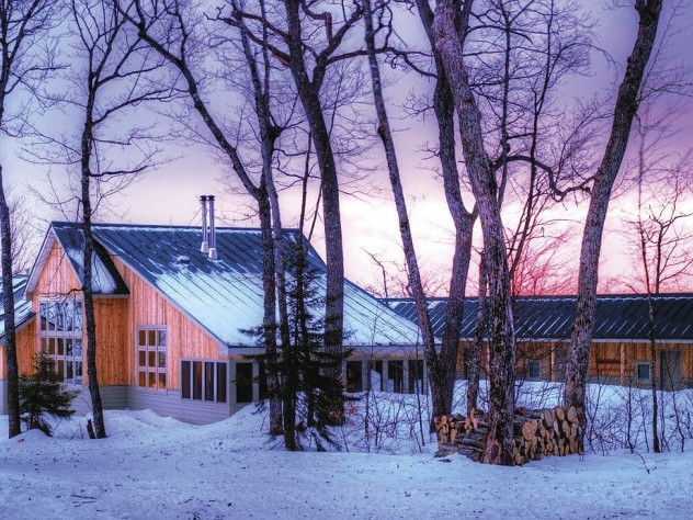 Maine Huts & Trails offers winter sunsets in the wilderness (along with food, hot showers, and convivial company) at the Stratton Brook Hut.