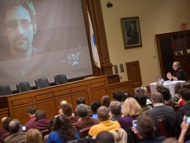The scene in Ames Courtroom as Lawrence Lessig spoke with Edward Snowden