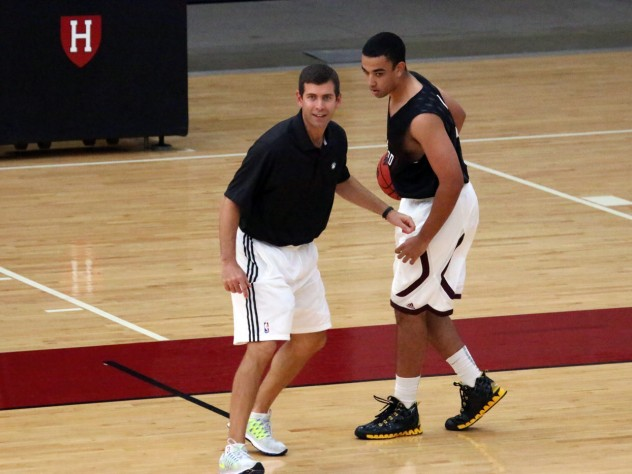 Besides discussing how he approaches coaching, Boston Celtics head coach Brad Stevens (at left) ran drills with members of the Harvard club basketball team, including James McCaffrey '15.