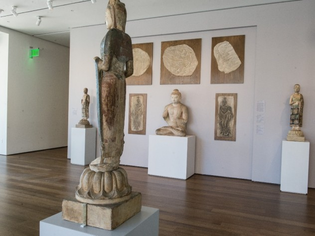Natural daylight accentuates the materials of the sculptures—marble, sandstone, lingering traces of colored pigments and gold decorations—in one of the museums' galleries of Buddhist art.