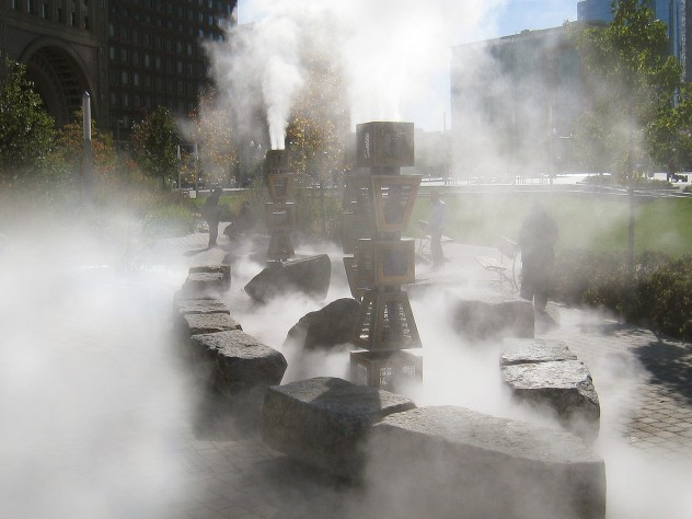 Fog envelopes <i>Harbor Fog</i>, the installation that was constructed with stones salvaged from old seawalls.