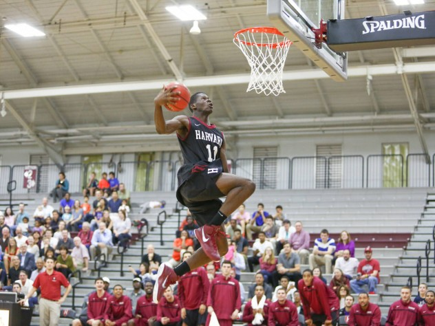 Freshman Chris Egi (shown here participating in Friday's dunk contest) will compete for playing time in a crowded Harvard frontcourt.